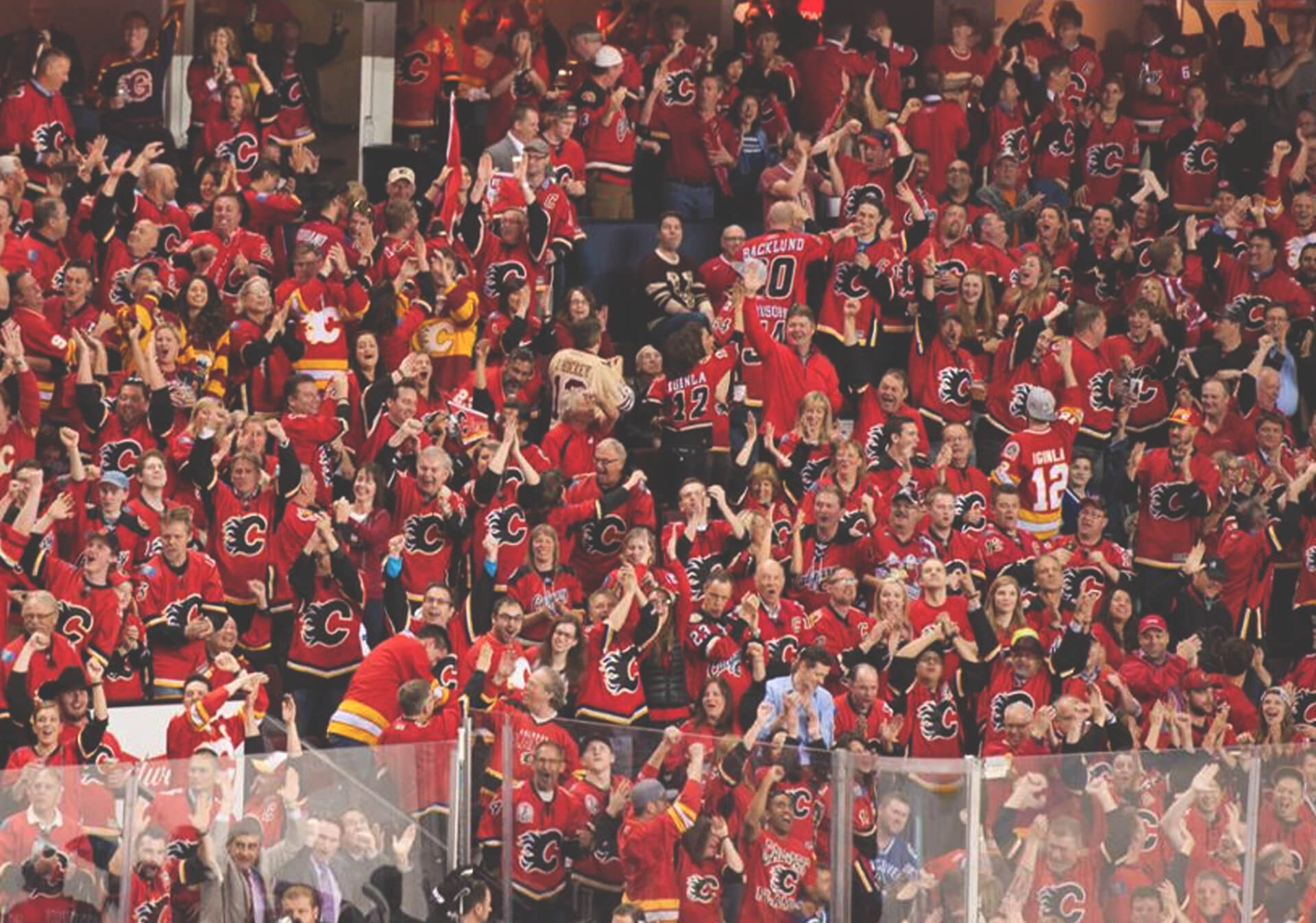 Calgary Flames NHL Fans cheering wildly in the stands