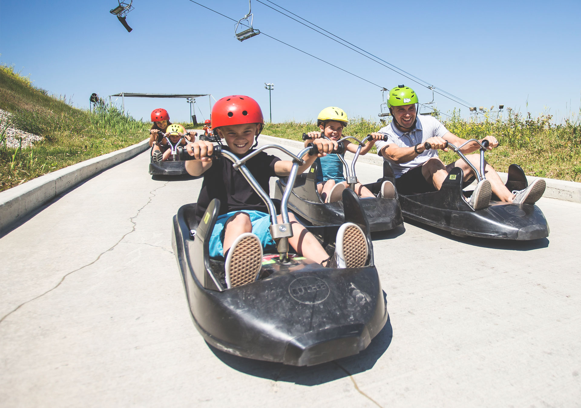 Riding luge cart down Skyline Luge track at Winsport