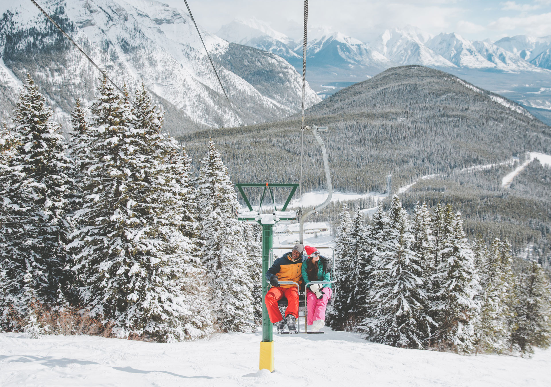 Riding the chairlift at Mount Norquay Ski Resort (Photo credit: Travel Alberta/Mike Seehagel).