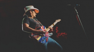 Brad Paisley performing on stage